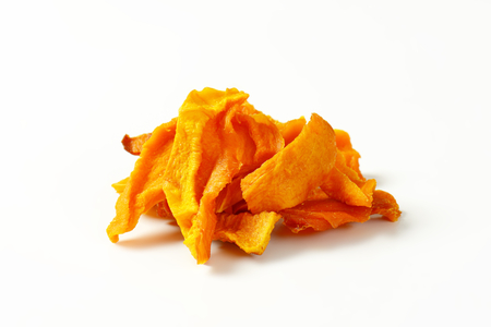 Heap of dried mango slices on white background