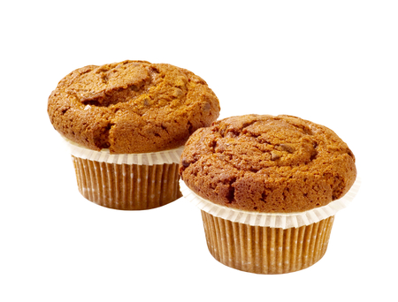 quick snack: Two pumpkin muffins isolated on white