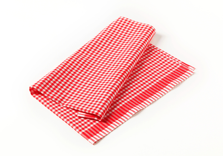 dishcloth: Red and white tea towel on white background Stock Photo