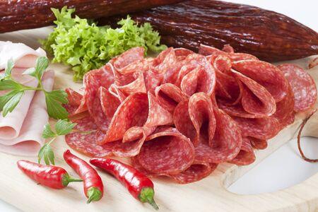 air dried: sliced salami on cutting board
