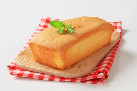 pound cake: loaf of pound cake on wooden cutting board
