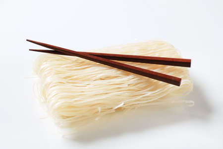 rice noodles: Bundle of dried rice noodles and wooden chopsticks Stock Photo