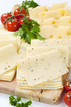 peppered: variety of sliced cheeses on cutting board