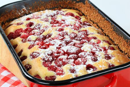 baking tray: fresh baked raspberry sponge cake in baking tray