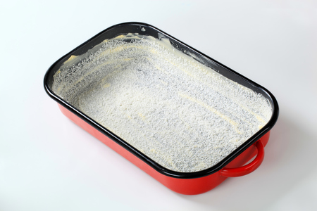 greased: greased baking tin covered with desiccated coconut