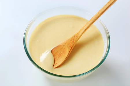 batter: bowl of raw batter and wooden spoon Stock Photo