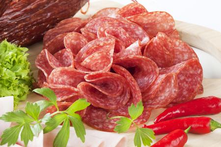 air dried salami: sliced salami on cutting board
