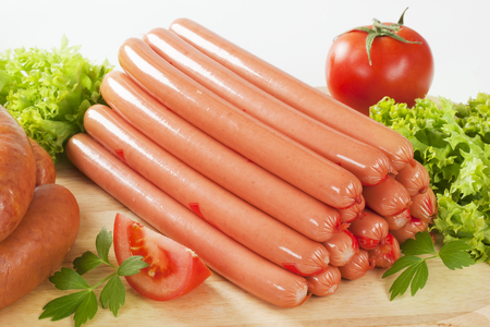 stack of sausages on cutting board