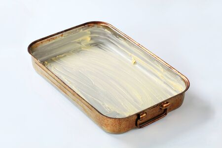 greased: baking pan greased with butter Stock Photo