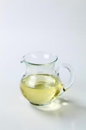 sunflower oil: glass jug of sunflower oil