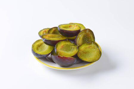 halved  half: Halves of fresh ripe plums