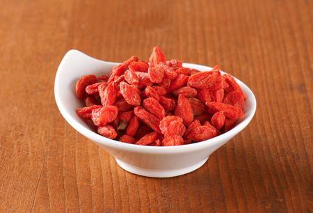 barbarum: Dried goji berries in small bowl Stock Photo