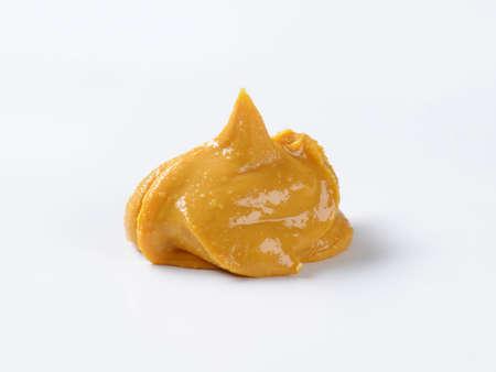 creamy: Creamy peanut butter on white background