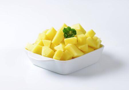 diced: Raw diced potatoes in ceramic dish Stock Photo