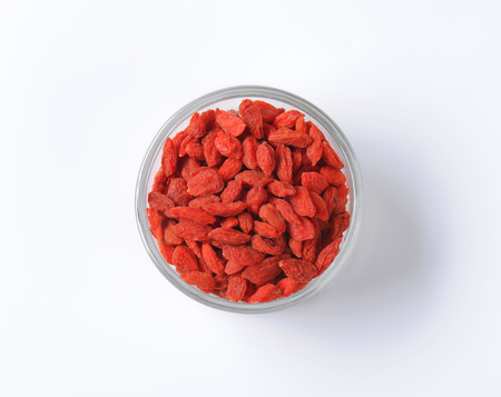 glass bowl: Dried goji berries in small glass bowl Stock Photo