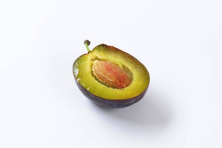halved  half: Half a plum with stone