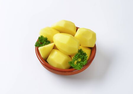 peeled: Raw peeled potatoes in ceramic dish