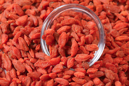glass bowl: Dried wolf berries with glass bowl Stock Photo
