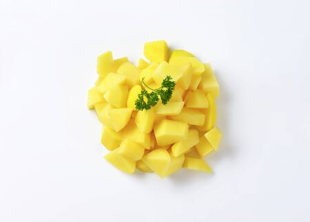 diced: Pile of diced raw potatoes