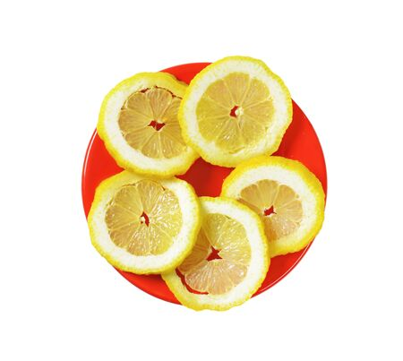 lemon slice: Slices of fresh lemon on a red plate