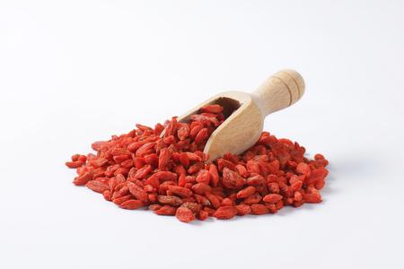 barbarum: Pile of dried goji berries and wooden scoop