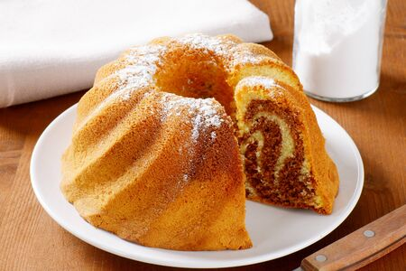 cut off: Chocolate and vanilla bundt cake, slices cut off