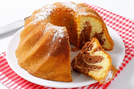 Chocolate and vanilla bundt cake, slice cut off