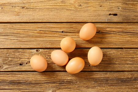 brown eggs: Fresh brown eggs on wooden surface