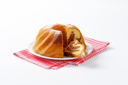 cut off: Chocolate and vanilla bundt cake, slice cut off