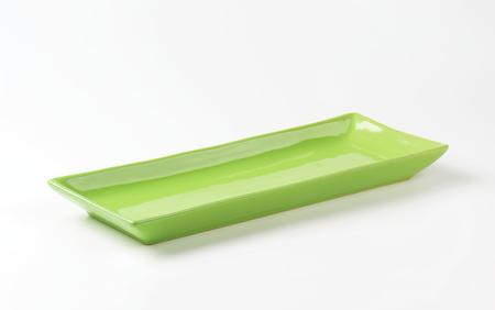 rectangular: Long rectangular green ceramic serving platter Stock Photo