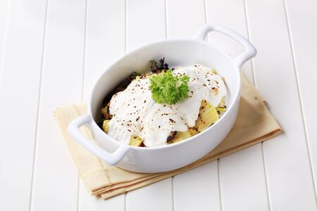 casserole dish: Potatoes and sour cream in a casserole dish Stock Photo