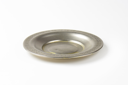 Vintage metal saucer plate with decorative rim