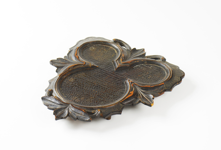 hand carved: Vintage hand carved wood trivet Stock Photo