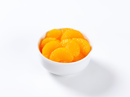segments: Bowl of peeled mandarin orange segments in light syrup