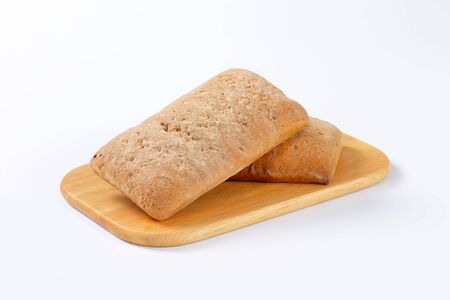 spice cake: Two gingerbread biscuits on cutting board Stock Photo