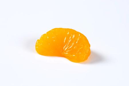 mandarin orange: Studio shot of a single peeled mandarin orange segment
