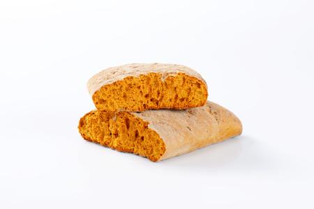 halved  half: Halved gingerbread biscuit on white background