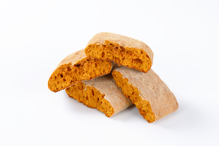 halved  half: Halved gingerbread biscuits on white background Stock Photo