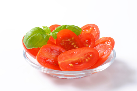 halved: Halved fresh oval-shaped red tomatoes Stock Photo