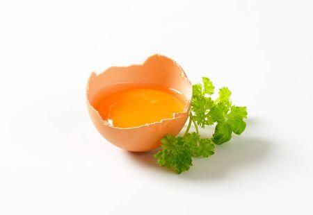 eggshell: Egg yolk in half an eggshell
