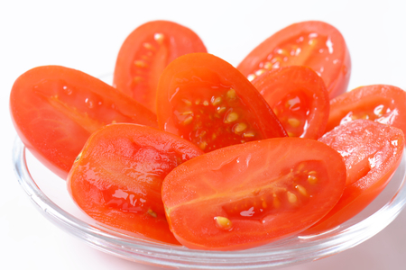 oblong: Halved fresh oval-shaped red tomatoes Stock Photo