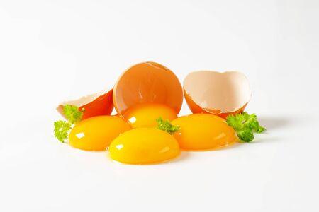 eggshell: Four fresh egg yolks and eggshell Stock Photo