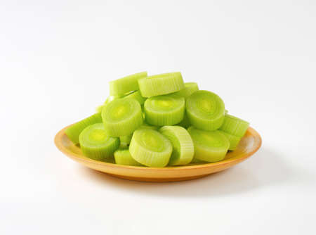 leek: plate of leek slices on white background