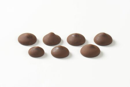 chocolate chips: Chocolate chips on white background Stock Photo