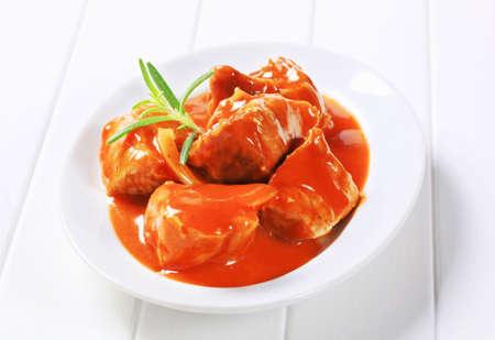 chunks: Chunks of pork meat in tomato sauce Stock Photo