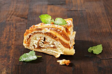 yeast: slice of yeast cake with nut filling Stock Photo