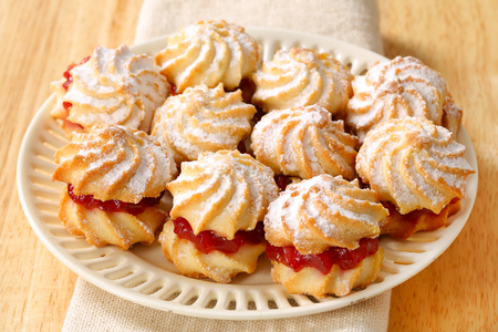 icing sugar: Jam sandwich cookies powdered with icing sugar Stock Photo
