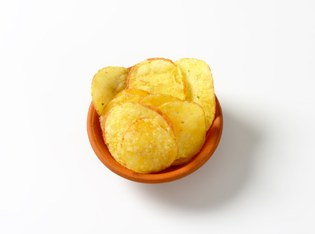 nibbles: Heap of potato chips in a bowl Stock Photo