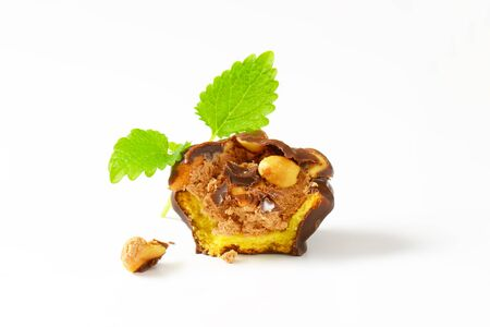 halved  half: chocolate coated cookie cup with peanut butter filling