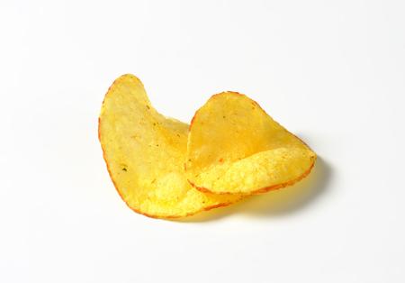 nibbles: Studio shot of crunchy crisps Stock Photo
